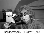 Surgeon show strange tool before coming difficult surgery - stock photo
