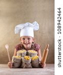 Happy laughing chef child with pasta assortment in burlap bags and kitchen utensils - traditional food - stock photo