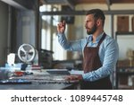 young master at work in workshop | Shutterstock . vector #1089445748