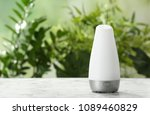 aroma oil diffuser on table... | Shutterstock . vector #1089460829