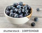 small bowl full of blueberries  ... | Shutterstock . vector #1089504068