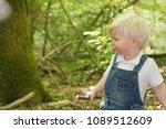 toddler in dungarees in the... | Shutterstock . vector #1089512609