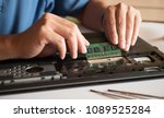 the engineer repairs the laptop ... | Shutterstock . vector #1089525284