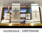 Small photo of SINGAPORE - APR 22, 2018: Laphroaig Islay single malt Scotch whisky on store shelf of Changi Airport New Terminal 4. Whisky is a major export item of Scotland.