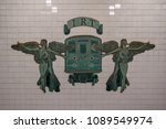 Small photo of New York City - April 20, 2018: IRT (Interborough Rapid Transit Company) New York City Subway sign at Grand Army Plaza Brooklyn, New York. Two trumpeting angels flanking an early 1900s train.
