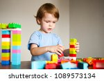 the child plays with colorful... | Shutterstock . vector #1089573134