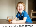 cheerful child drinks juice for ... | Shutterstock . vector #1089577880