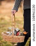 hand with basket full of food.... | Shutterstock . vector #108961130