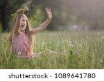 cute happy girl plays in the... | Shutterstock . vector #1089641780