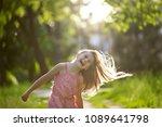 joyfull little girl is shaking... | Shutterstock . vector #1089641798
