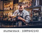 stylish brutal barman in a... | Shutterstock . vector #1089642143