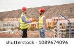 builders on residential... | Shutterstock . vector #1089674096