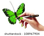 Woman's hand is painting a vivid green butterfly with a fountain pen - stock photo
