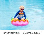 happy child on inflatable ice... | Shutterstock . vector #1089685313