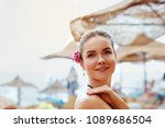 a female  applying sun cream... | Shutterstock . vector #1089686504