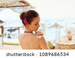 tan woman applying sun... | Shutterstock . vector #1089686534