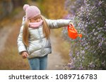 little girl watering the... | Shutterstock . vector #1089716783