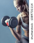 fitness young woman with heavy... | Shutterstock . vector #1089731114