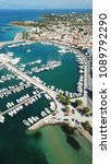 Small photo of Aerial drone bird's eye view photo of picturesque port of Aigina island, Saronic Gulf, Greece
