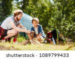 young scout showing his son how ... | Shutterstock . vector #1089799433