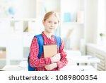 diligent schoolgirl with blue... | Shutterstock . vector #1089800354