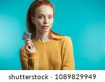 young redhaired woman showing... | Shutterstock . vector #1089829949