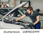 mechanic perform vehicle... | Shutterstock . vector #1089833999