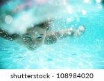 Child Swimming Underwater In...
