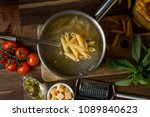 home cooking pasta in a... | Shutterstock . vector #1089840623