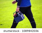 Small photo of water carrier in a football match