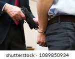 agent arresting a businessman | Shutterstock . vector #1089850934