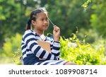 little girl relaxing and... | Shutterstock . vector #1089908714