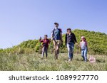 portrait of a family in a hike... | Shutterstock . vector #1089927770