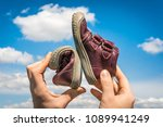 woman is holding barefoot shoes ... | Shutterstock . vector #1089941249