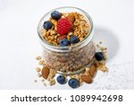 homemade muesli in a glass jar... | Shutterstock . vector #1089942698
