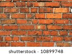 Old red brick wall close up. - stock photo