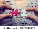 the man playing the jigsaw... | Shutterstock . vector #1089984089