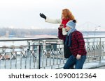 couple at barrier looking in... | Shutterstock . vector #1090012364