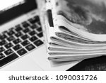 newspapers and laptop. pile of... | Shutterstock . vector #1090031726