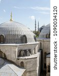 Small photo of Istanbul Turkey, May 12, 2018, partial view of the exterior through a window of the museum mosque of Aya Sofia, in the background you can see the minarets of the blue mosque
