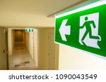 Fire exit sign at  the corridor ...