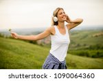 happy young woman in nature... | Shutterstock . vector #1090064360