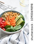 Small photo of Healthy buddha bowl, salad bowl or nourishing bowl with vegetables, chickpea and quinoa. Selective focus. Concept of healthy eating, healthy lifestyle, detox diet, vegan and vegetarian food