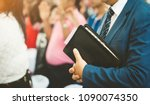 pastor holding a bible ready... | Shutterstock . vector #1090074350