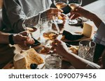 wine and cheese served for a... | Shutterstock . vector #1090079456