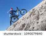 young guy with a bicycle on a...   Shutterstock . vector #1090079840