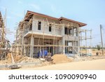 house under construction with autoclaved aerated concrete block structure at building site - stock photo