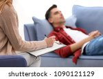 female psychologist with client ... | Shutterstock . vector #1090121129