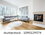 wooden table on a round rug... | Shutterstock . vector #1090129574
