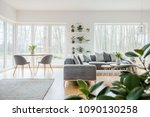 grey armchairs at wooden table... | Shutterstock . vector #1090130258